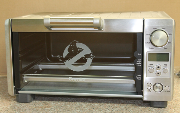 Toaster oven with sandblasted Ghostbuster logo.