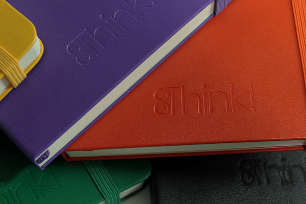 Debossed logo on different color notebooks
