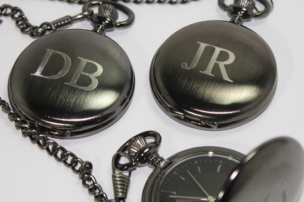 Diamond engraved initials on metal pocket watches.