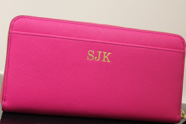 Woman's wallet personalized by foil stamping initials.