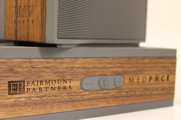 Grain audio speakers with two different logos laser engraved on two different locations.