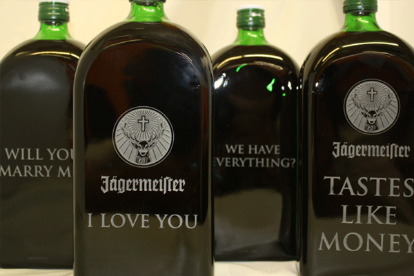 Liquor bottles with sandblasted messages.