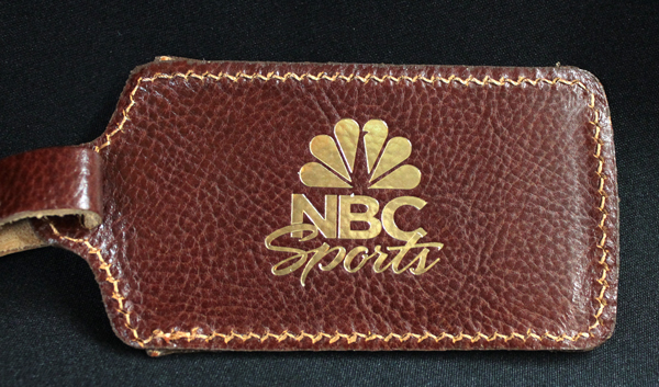 Leather luggage tag gold foil stamped with NBC Sports logo