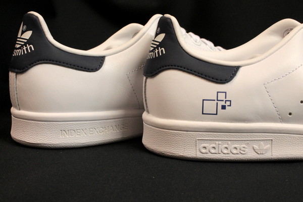Adidas sneakers with Index Exchange logo symbol pad printed and Index Exchange laser engraved.