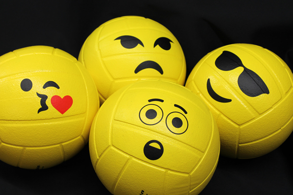 Yellow soccer ball with emoji faces.